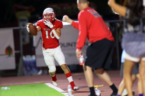 Arbor View's Logan Clogston (10) celebrates after making a catch in the end zone for a 2-point ...