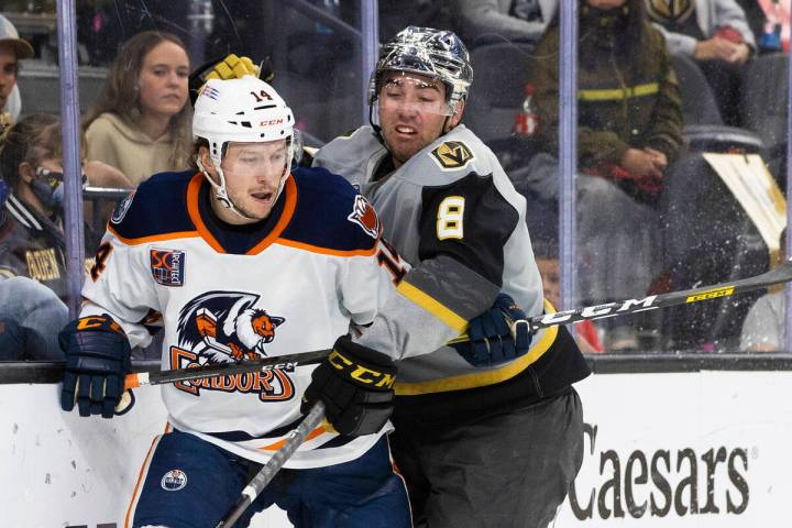 Henderson Silver Knights forward Jack Dugan (8) collides with Bakersfield Condors left wing Dev ...