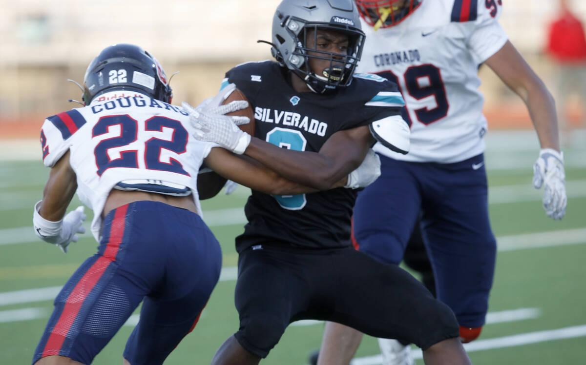 Silverado High School's John Agounke (6) plays against Coronado High School's Jeremiah Kunitake ...