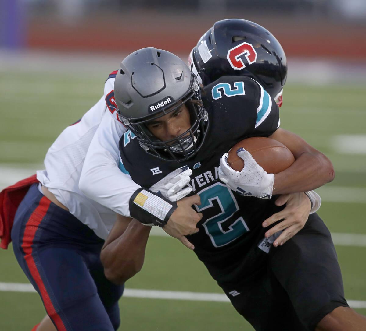Silverado High School's Donavyn Pellot (2) is tackled by Coronado High School's Logan Cheney ( ...