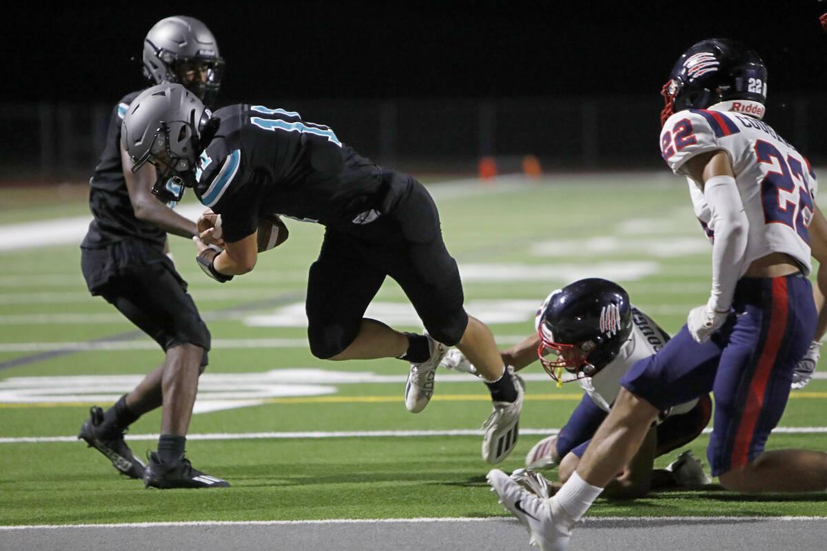 Silverado High School's Brandon Tunnell (11) scores a touchdown over Coronado High School's Pre ...