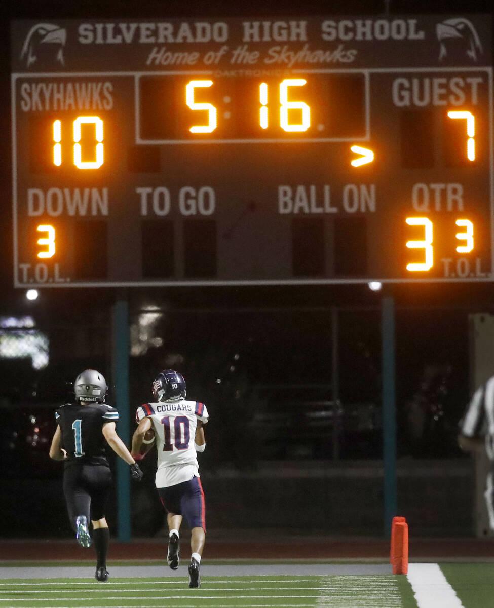 Coronado High School's Jaylen Garrison (10) runs into the end zone for a touchdown as Silverado ...