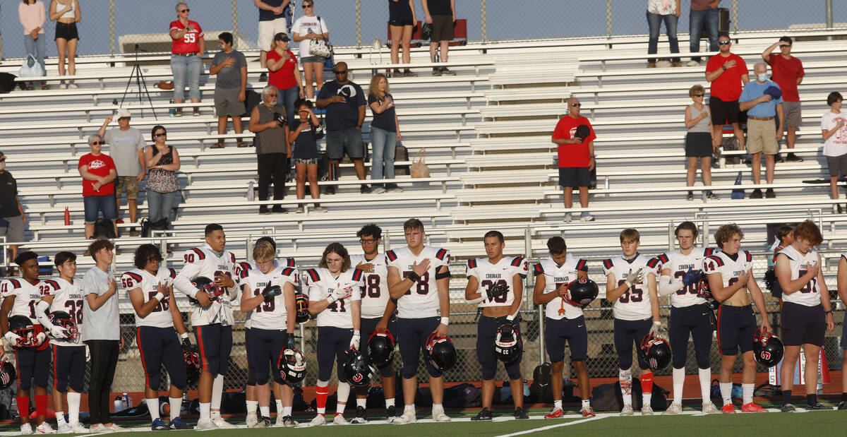 Coronado High School's players stand for the national anthem before a football game against Sil ...