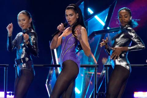 Dua Lipa, center, performs on the first night of the 2021 iHeartRadio Music Festival, Friday, S ...
