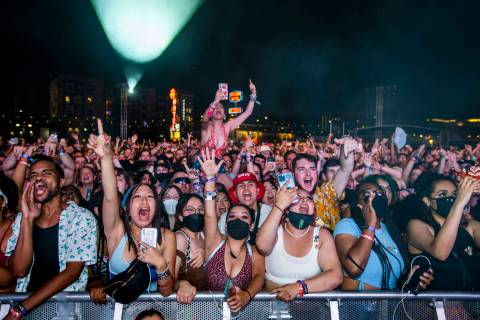 Fans yell and sing along as Ashnikko performs on the Bacardi Stage during day one of Life is Be ...