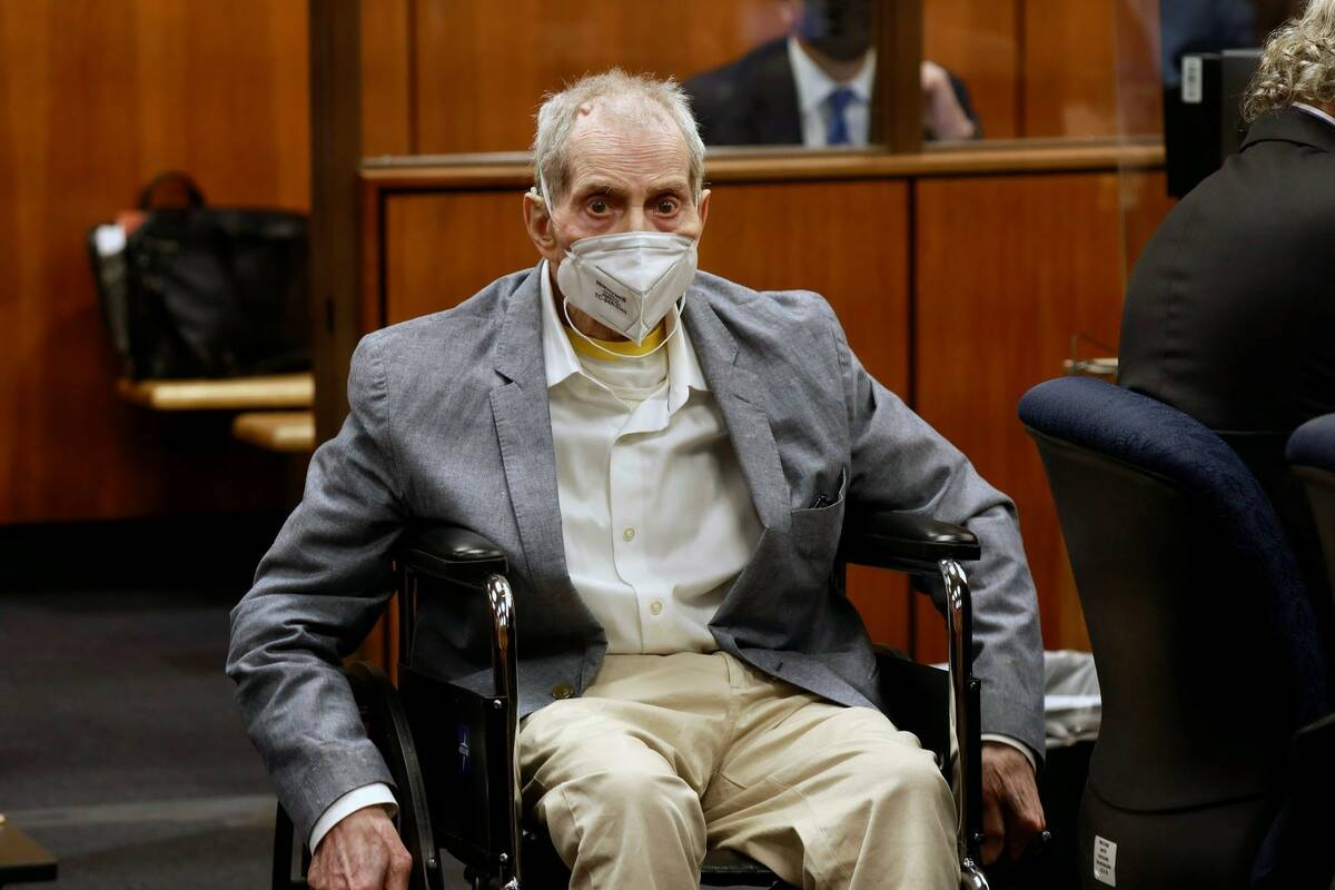 Robert Durst in his wheelchair spins in place as he looks at people in the courtroom during his ...
