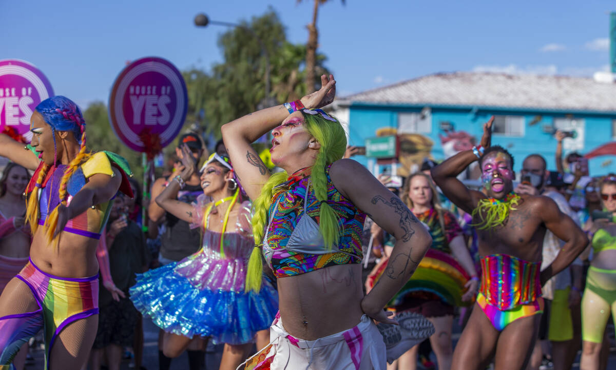 Dancers with The House of Yes perform during a Gay Pride parade on Fremont Street during day tw ...
