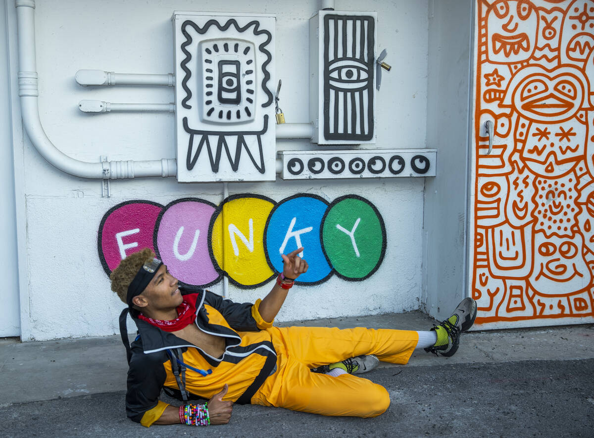 Cameron Conant of Hawaii with some of the fun art along an alleyway between South 7th and 8th s ...