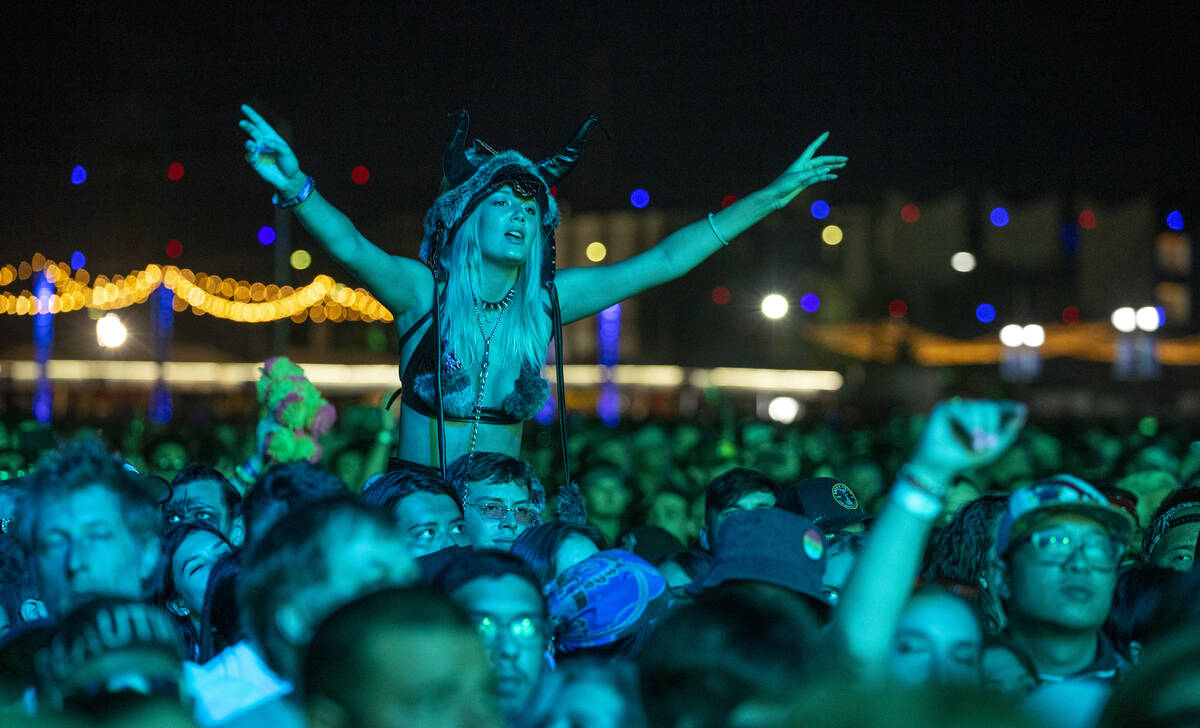 Fans listen while bathed in blue as Modest Mouse performs on the Downtown Stage during day two ...