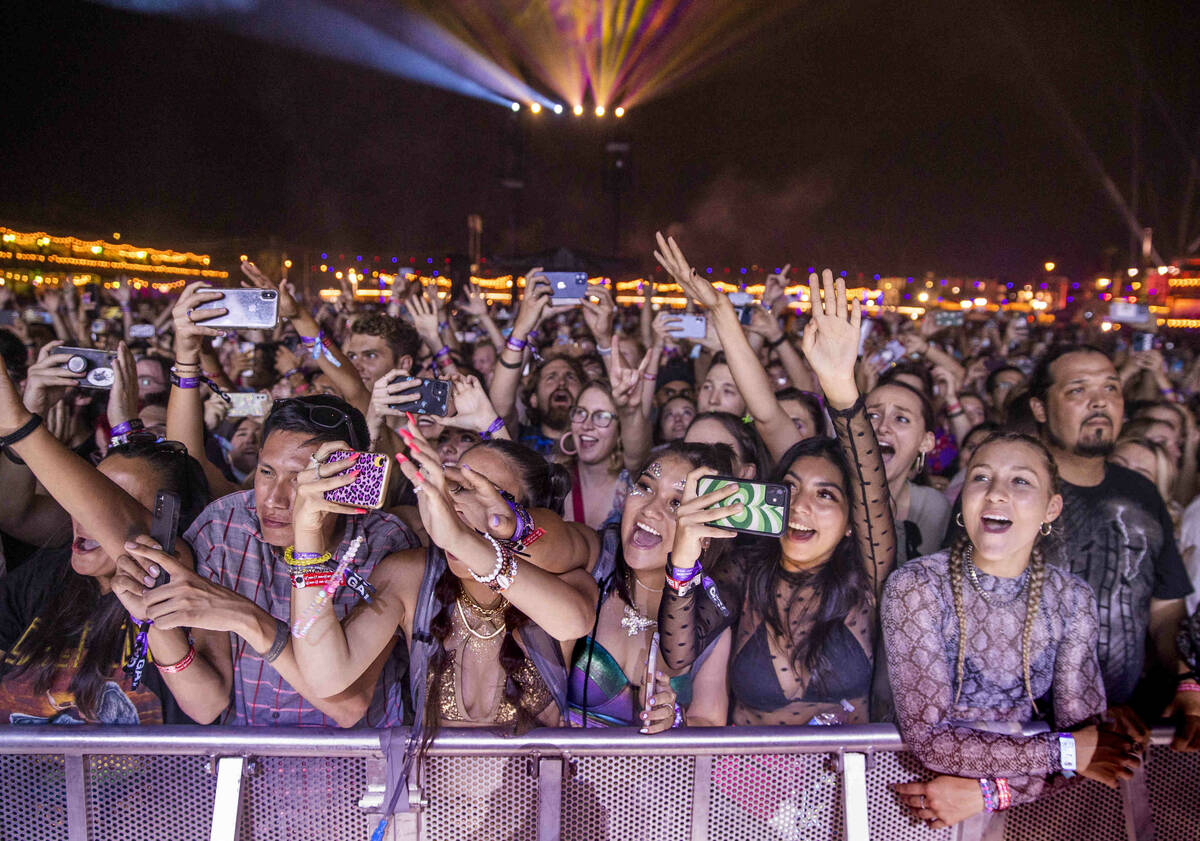 Fans cheer for Tame Impala performing on the Downtown Stage during day one of Life is Beautiful ...