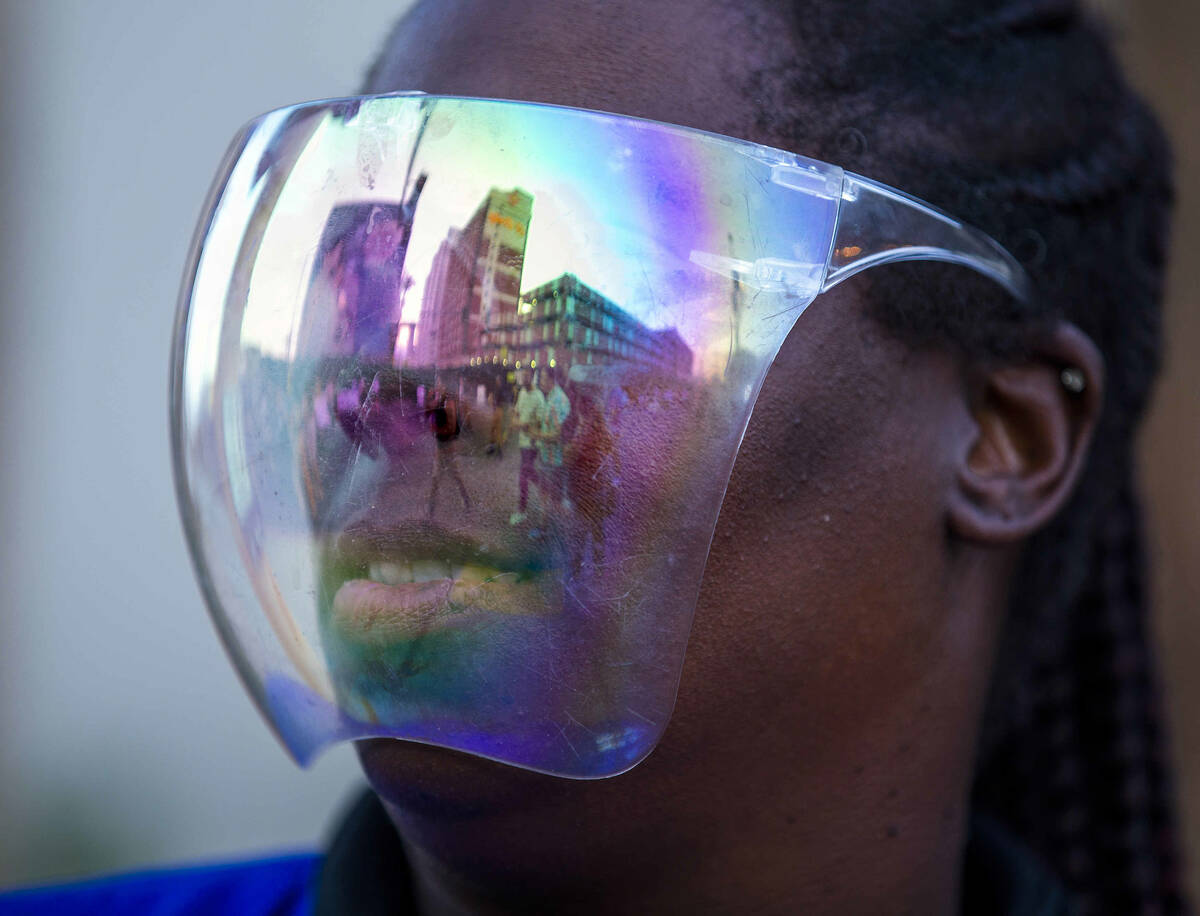 Shelley Ross with CSC Security has attendees reflected in her face shield during day one of Lif ...