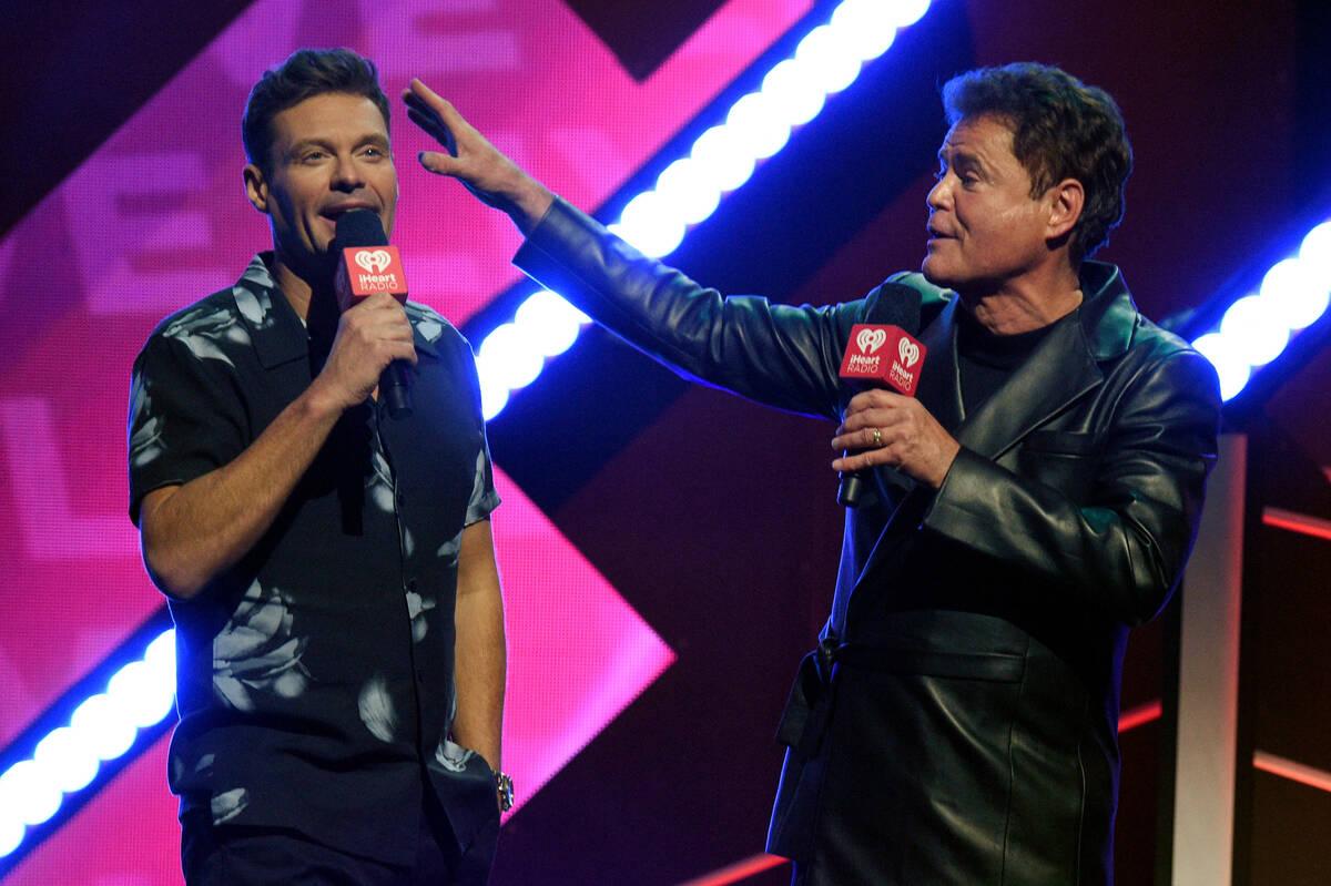 LAS VEGAS, NEVADA - SEPTEMBER 17: (L-R) Ryan Seacrest and Donny Osmond speak onstage during the ...