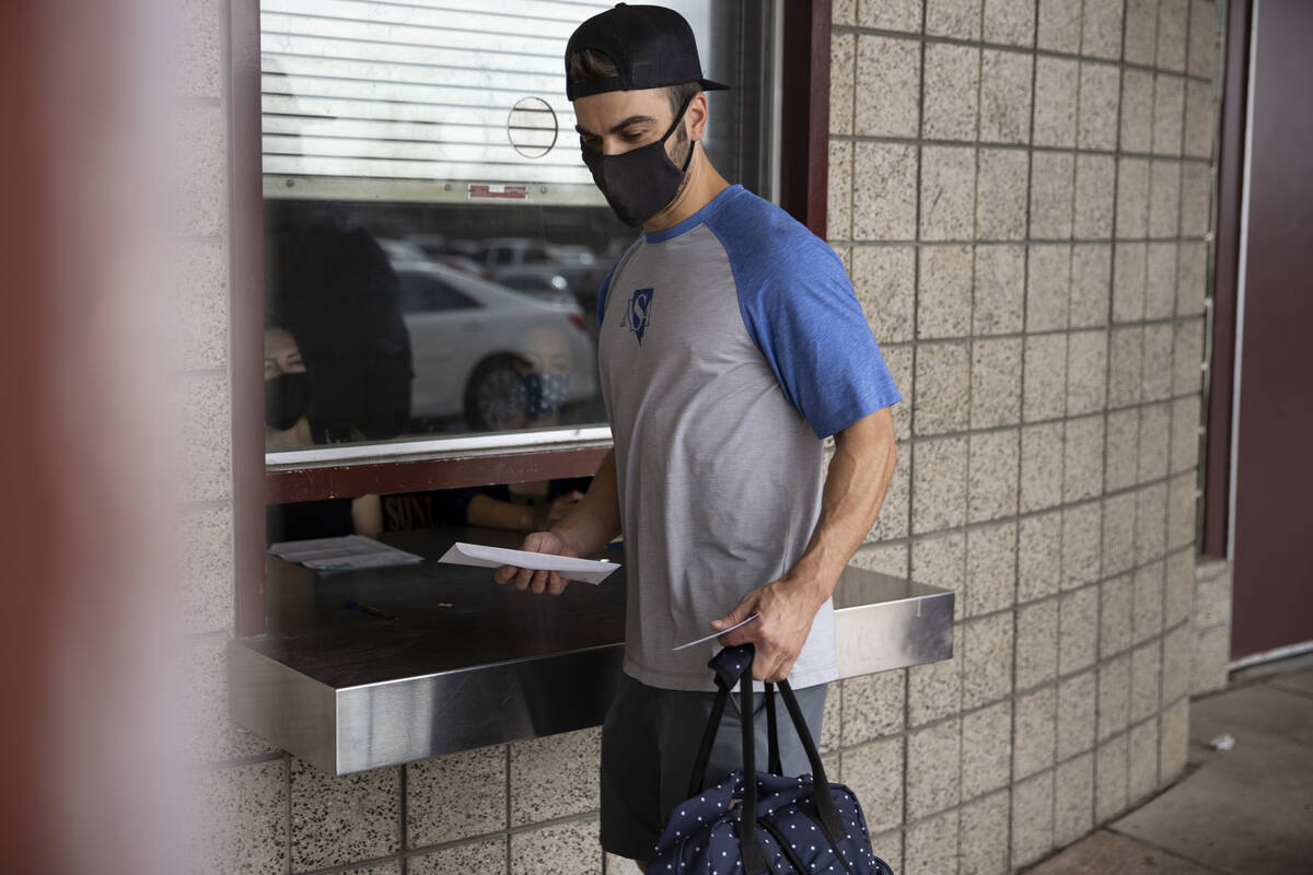 Keenan Laffoon of Las Vegas walks away with an $100 gift card after getting the COVID-19 vaccin ...
