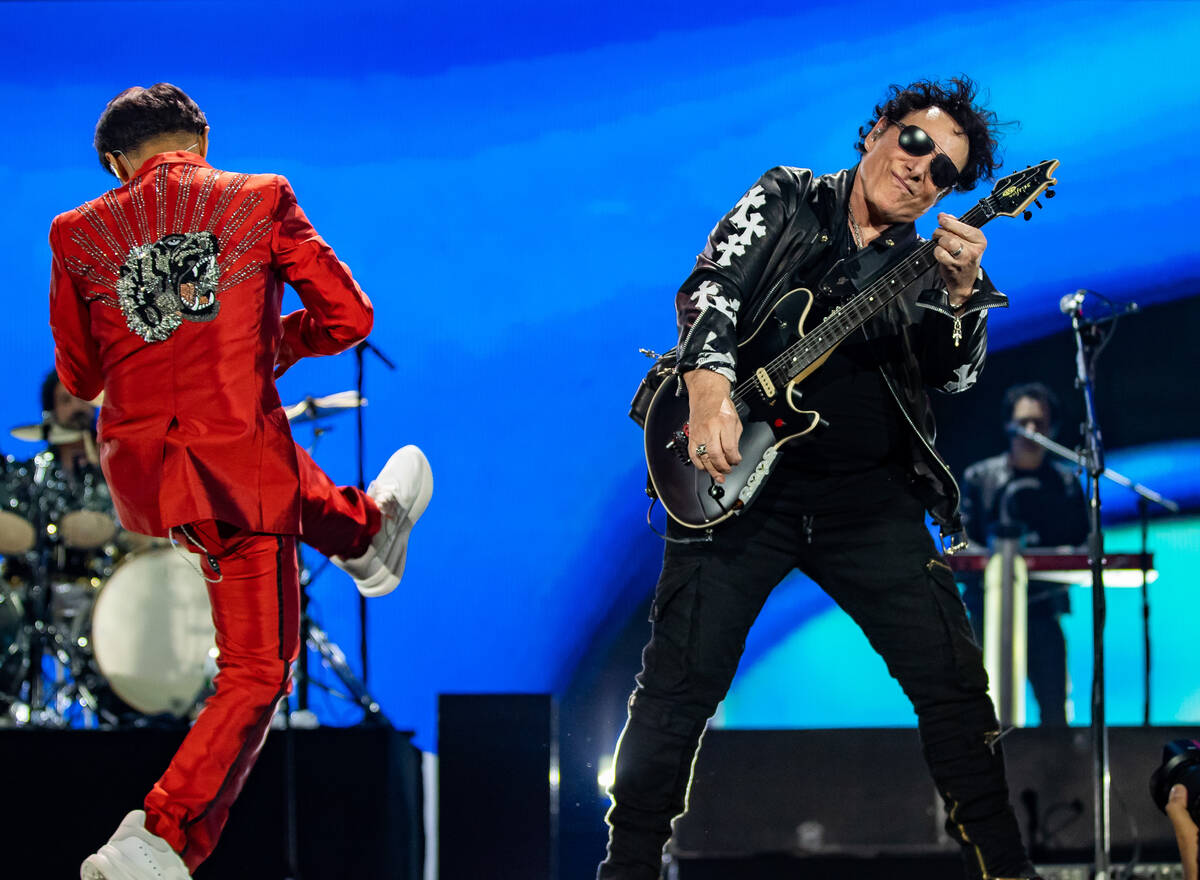 Arnel Pineda and Neal Schon of Journey performs during the 2021 iHeartRadio Music Festival at T ...