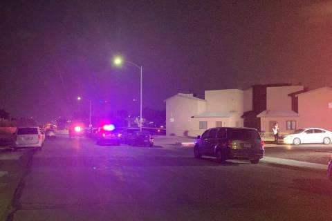 Police investigate a homicide near East Owens Avenue and North Sandhill Road in Las Vegas on Tu ...