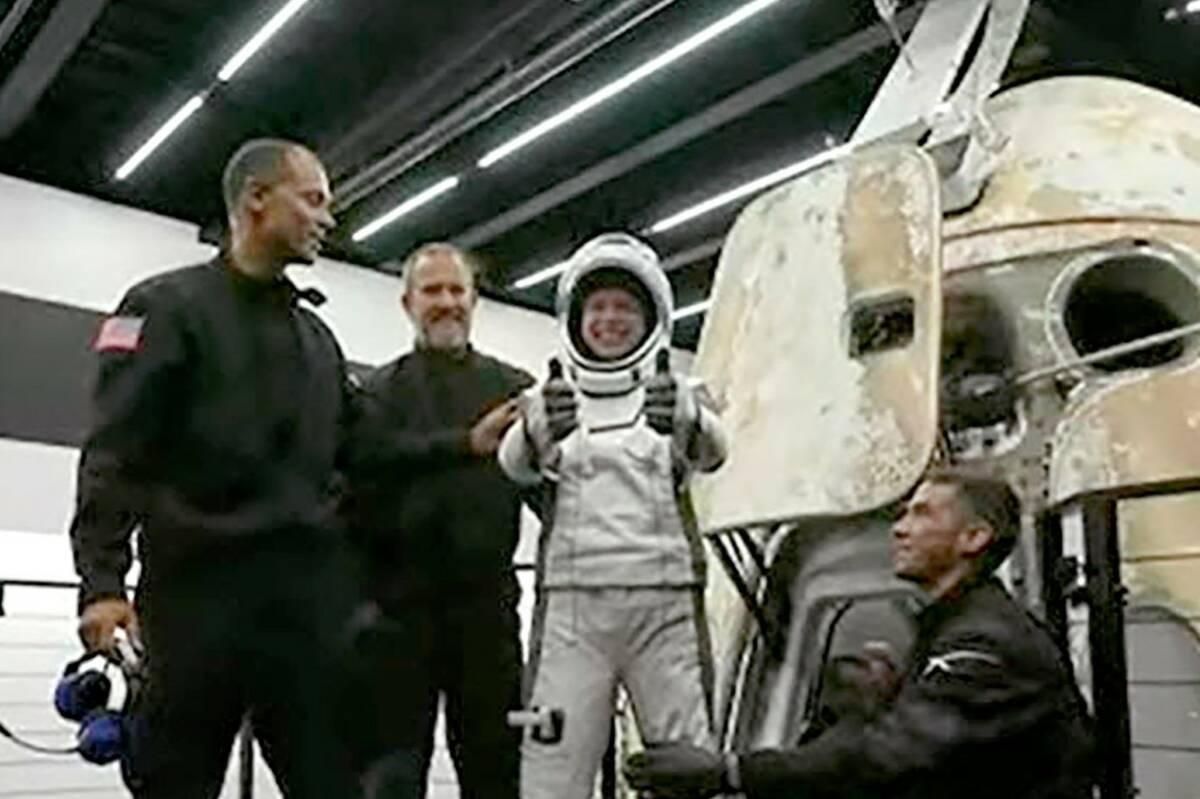 Hayley Arceneaux, one of four passengers aboard the SpaceX capsule, reacts after emerging from ...