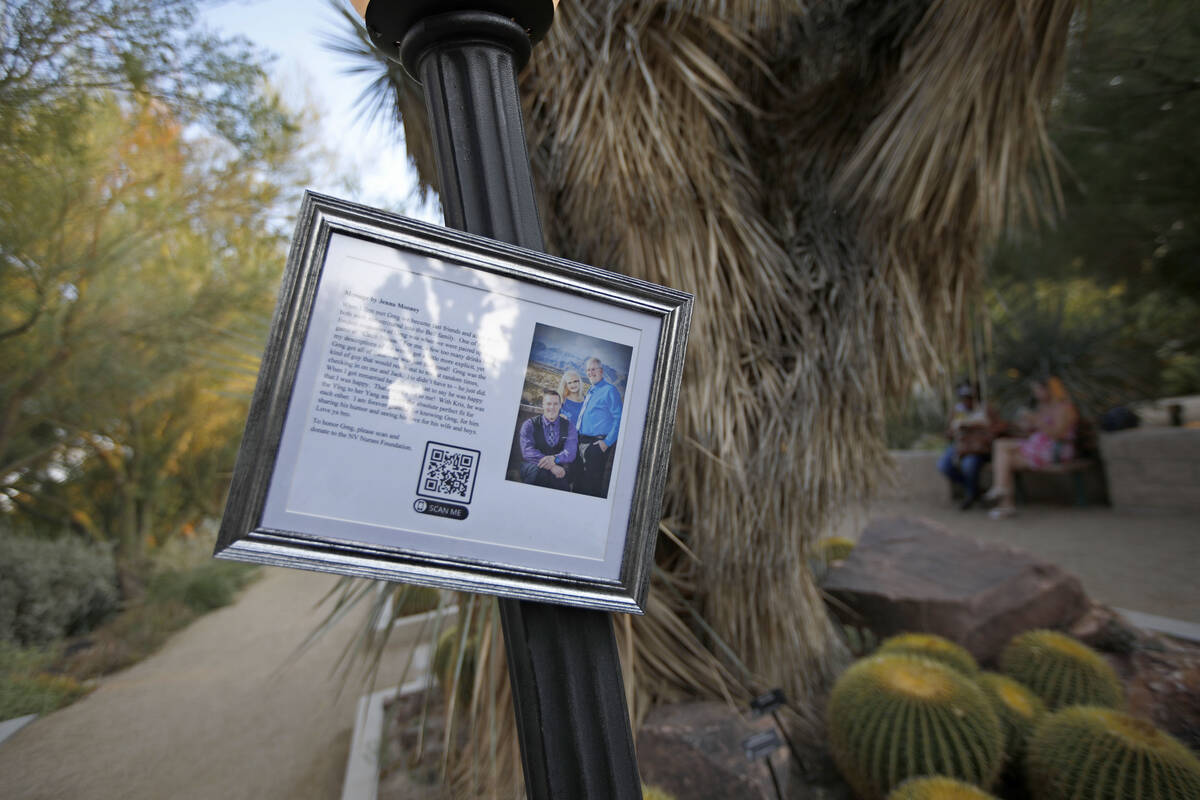 Greg Peistrup's photo is seen in the Botanical Garden during a celebration of life marki ...
