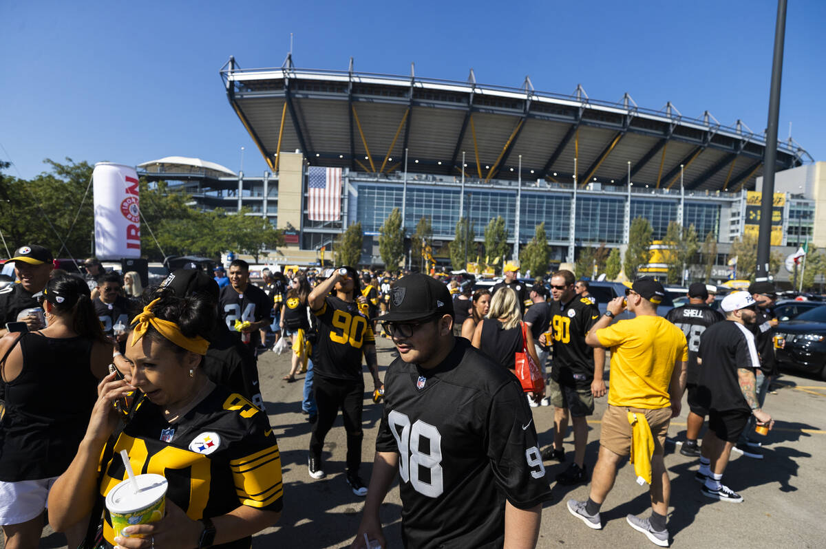 Raiders and Steelers fans at Heinz Field before the start of an NFL football game on Sunday, Se ...