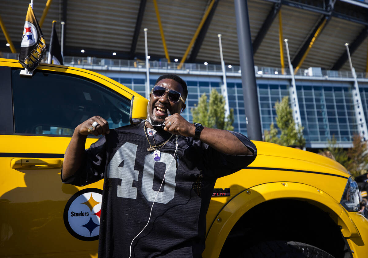 Raiders fan Tyron Abbington at Heinz Field before the start of an NFL football game against the ...