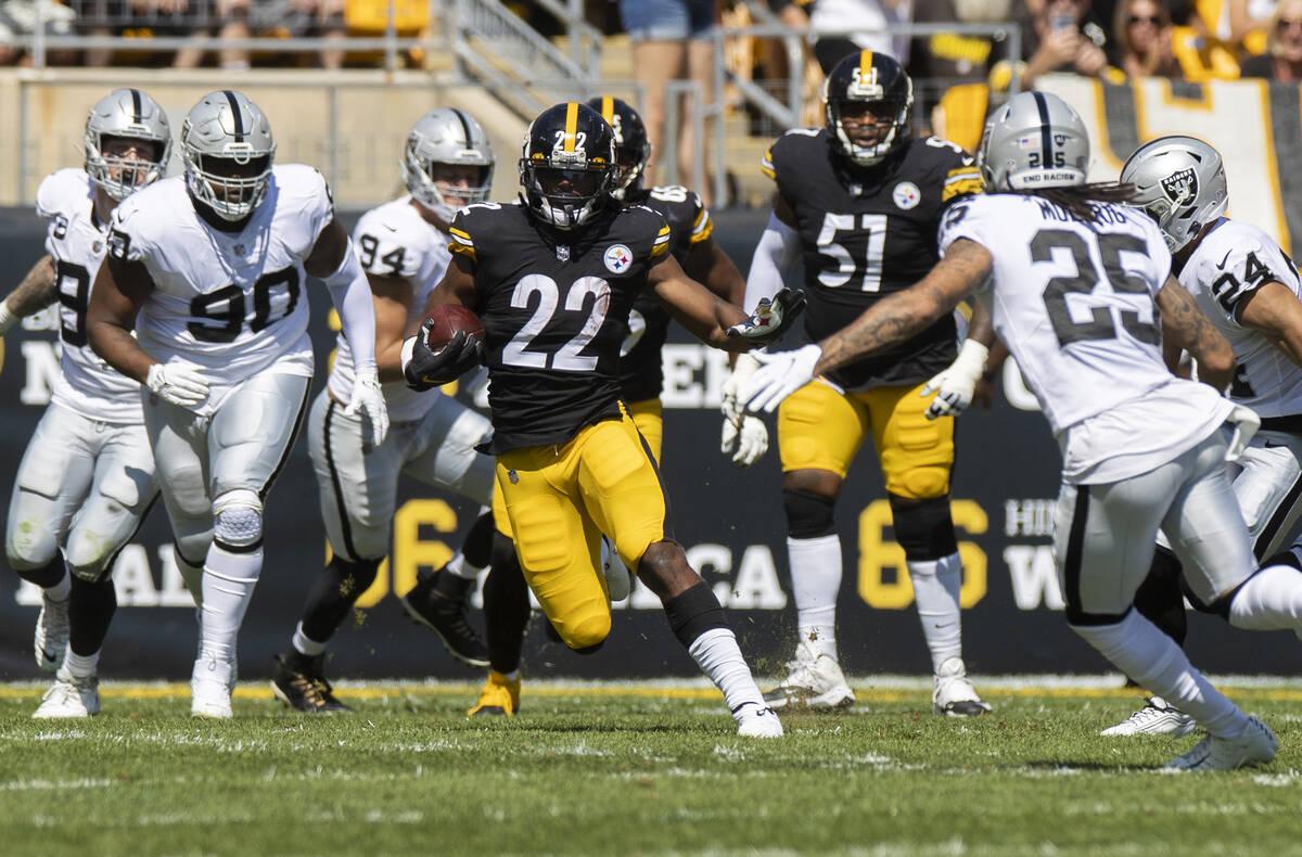 Pittsburgh Steelers running back Najee Harris (22) breaks off a big run past Raiders safety Tre ...