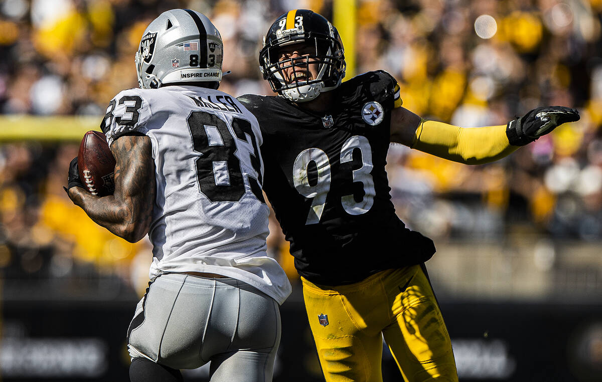 Raiders tight end Darren Waller (83) makes a big catch past Pittsburgh Steelers middle lineback ...
