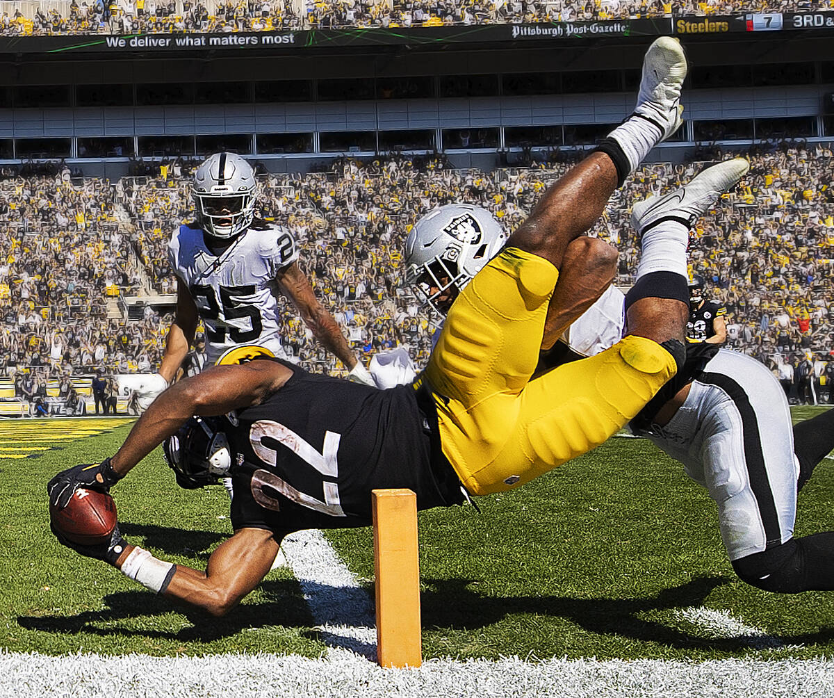 Pittsburgh Steelers running back Najee Harris (22) dives into the end zone for a touchdown past ...