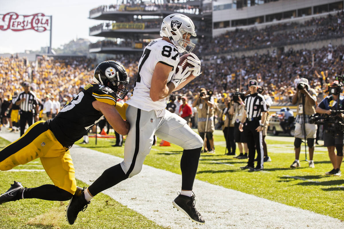 Raiders tight end Foster Moreau (87) catches a touchdown pass over Pittsburgh Steelers middle l ...