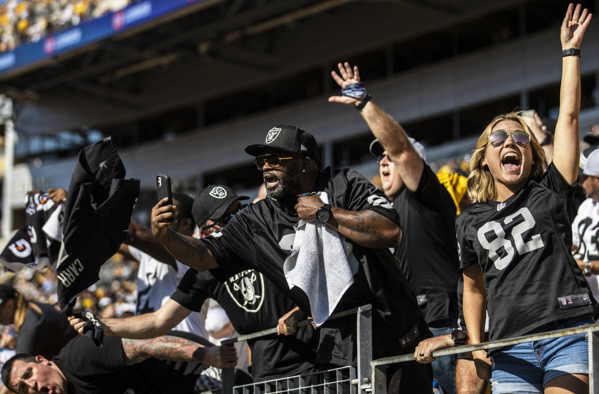 Raiders fans celebrate after beating the Pittsburgh Steelers at Heinz Field during an NFL footb ...