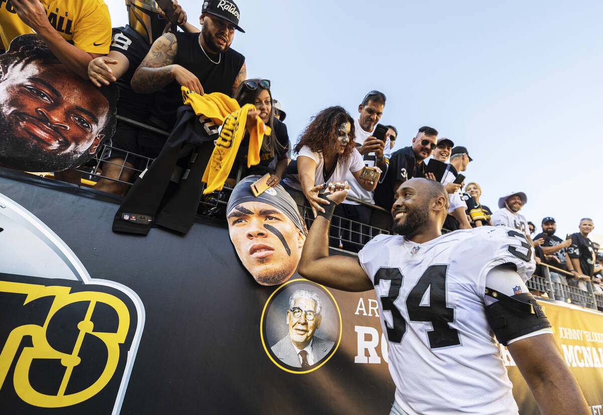 Raiders outside linebacker K.J. Wright (34) celebrates with fans after beating the Pittsburgh S ...