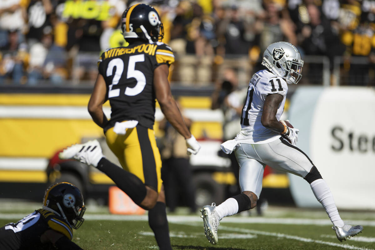 Raiders wide receiver Henry Ruggs III (11) catches a touchdown past Pittsburgh Steelers cornerb ...