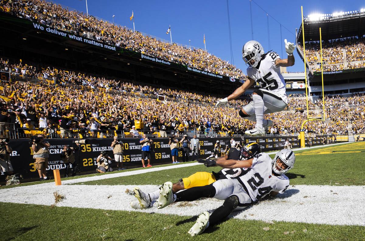 Raiders safety Trevon Moehrig (25) leaps over Pittsburgh Steelers running back Najee Harris (22 ...
