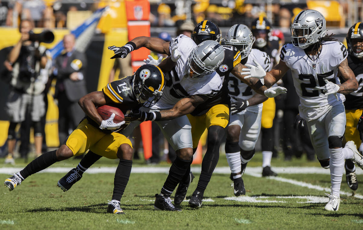 Raiders linebacker Javin White (53) tackles Pittsburgh Steelers wide receiver Ray-Ray McCloud ( ...