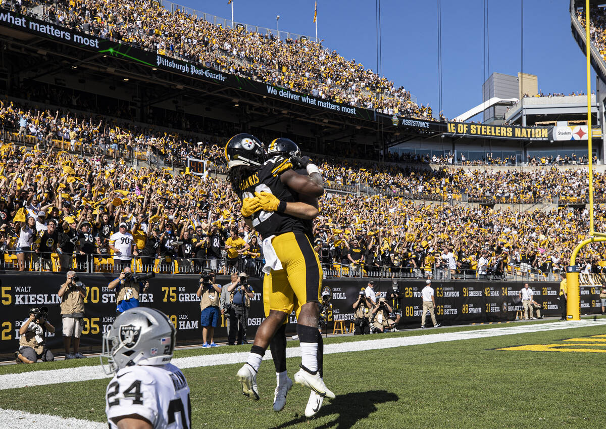 Pittsburgh Steelers running back Najee Harris (22) celebrates a touchdown over Raiders defensiv ...