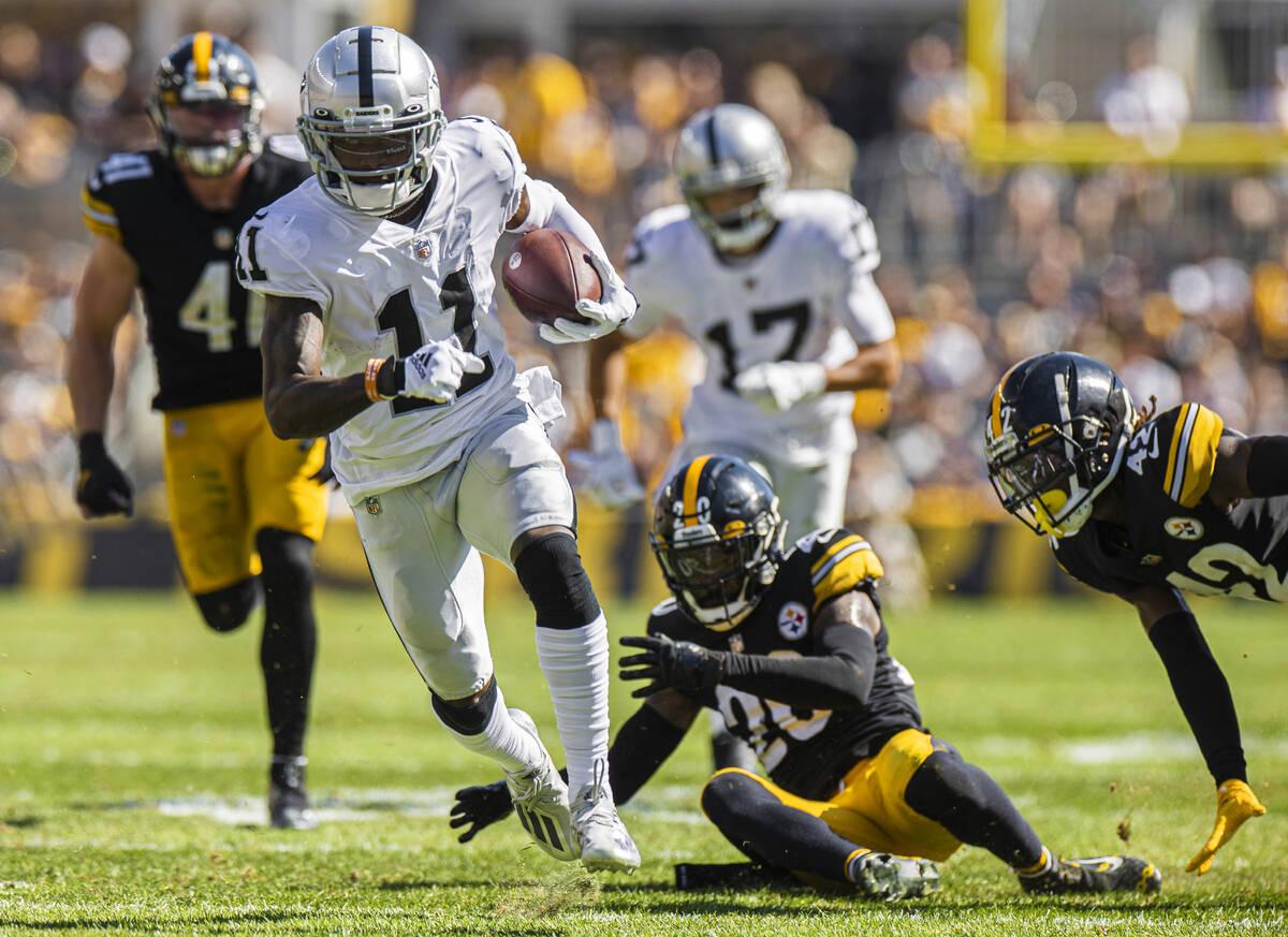 Raiders wide receiver Henry Ruggs III (11) breaks a big run past Pittsburgh Steelers cornerback ...