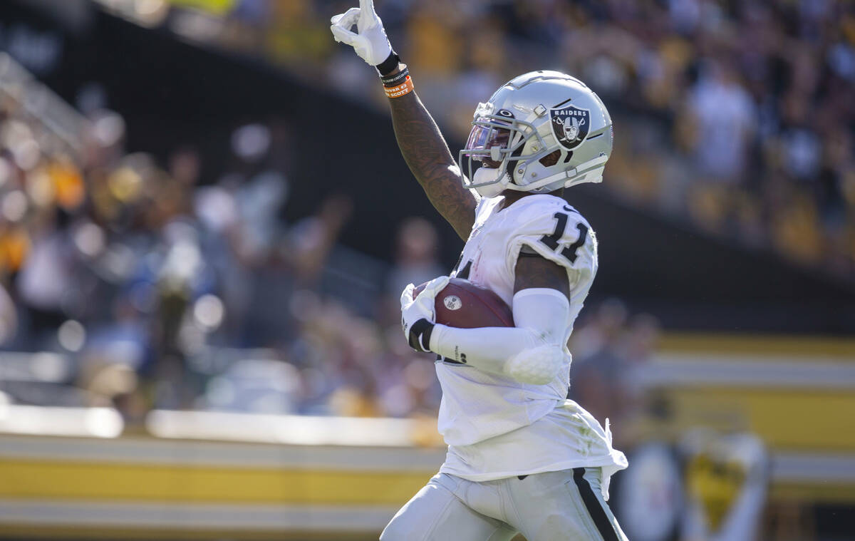 Raiders wide receiver Henry Ruggs III (11) runs into the end zone for a 61-yard touchdown durin ...