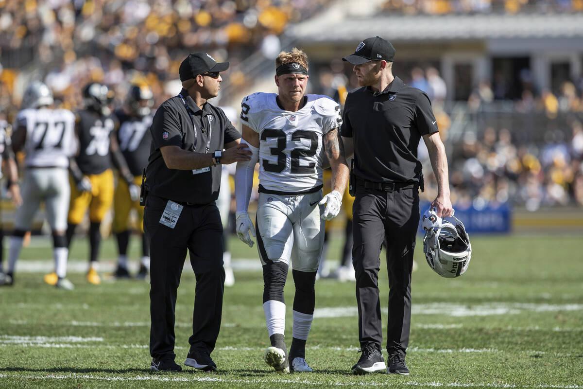 Las Vegas Raiders defensive back Dallin Leavitt (32) walks off the field after being injured du ...