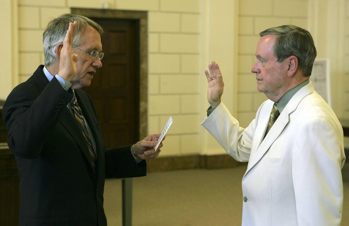 RJ FILE*** LOCAL - Senate Minority Leader Harry Reid, D-Nev., will swears in former U.S. Rep. J ...
