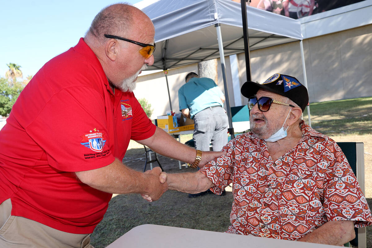 World War II veteran Vincent Shank, right, is congratulated by J.B. Brown on his 105th birthday ...