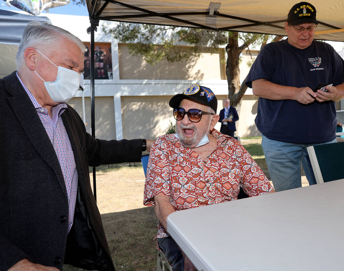 World War II veteran Vincent Shank, right, is honored by Gov. Steve Sisolak on his 105th birthd ...