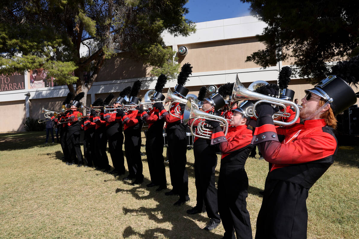 The UNLV marching band honors World War II veteran Vincent Shank on his 105th birthday at Chapa ...