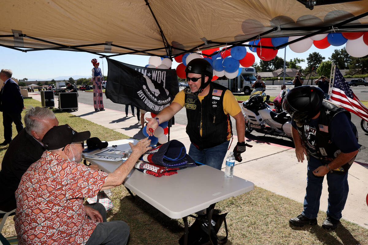 World War II veteran Vincent Shank, right, is honored by motorcyclists his 105th birthday at Ch ...