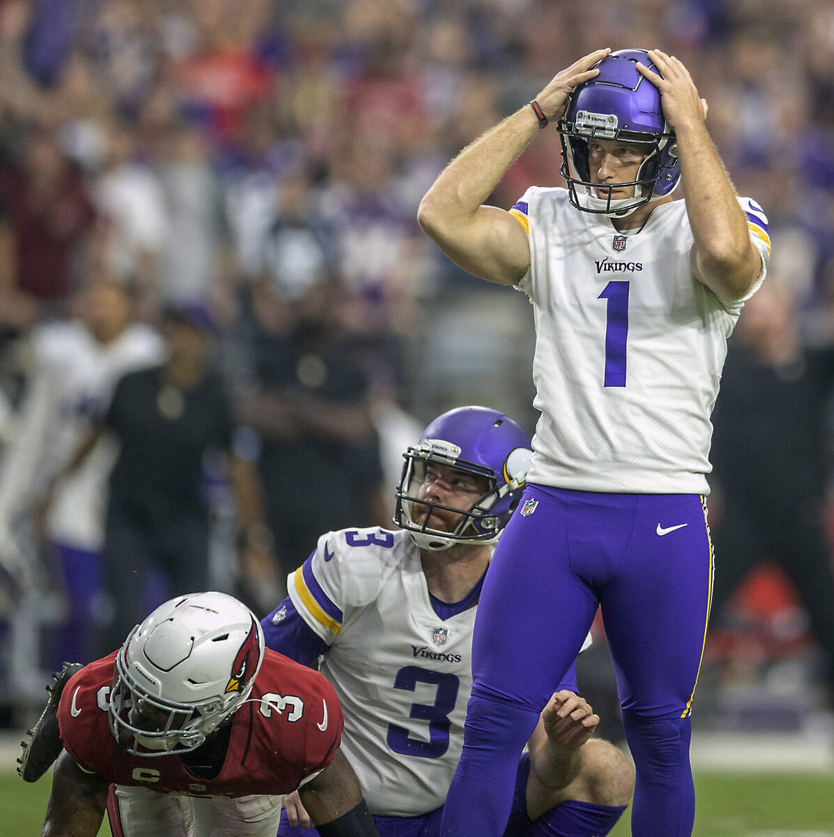 Minnesota Vikings kicker Greg Joseph (1) reacts after missing a field goal at the end of the fo ...