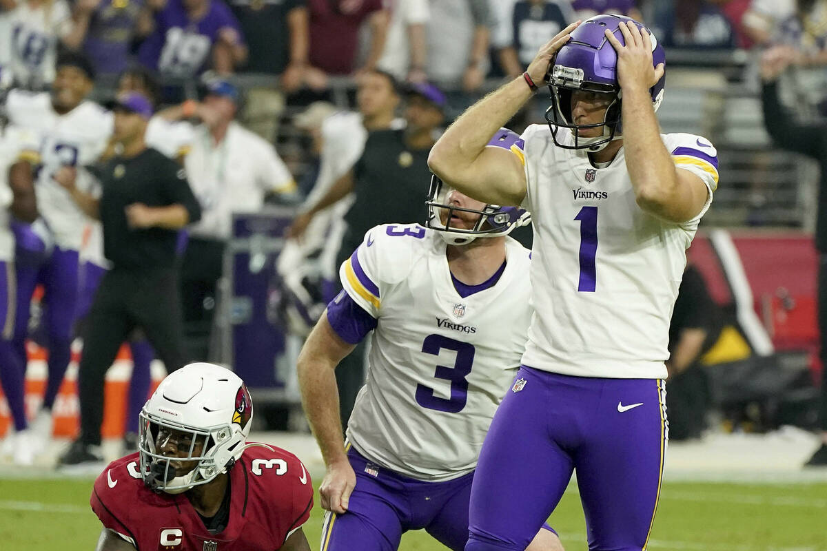 Minnesota Vikings kicker Greg Joseph reacts to missing a last second field goal as teammate Jor ...