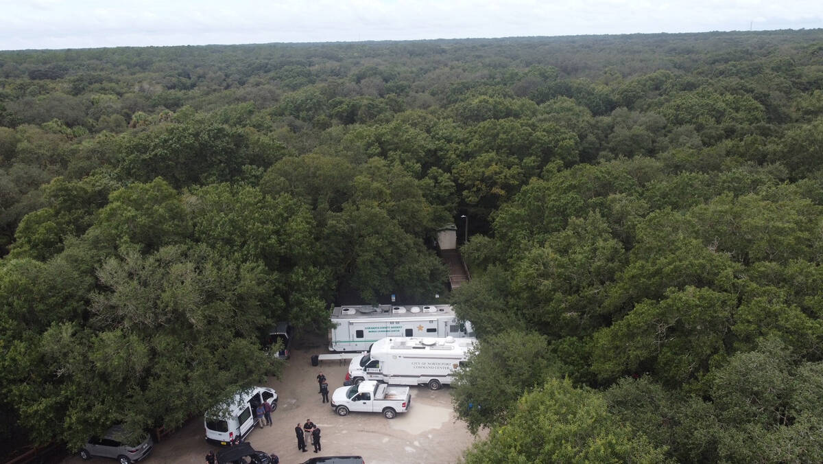 In this photo provided by North Port Police Department, law enforcement officials conduct a sea ...