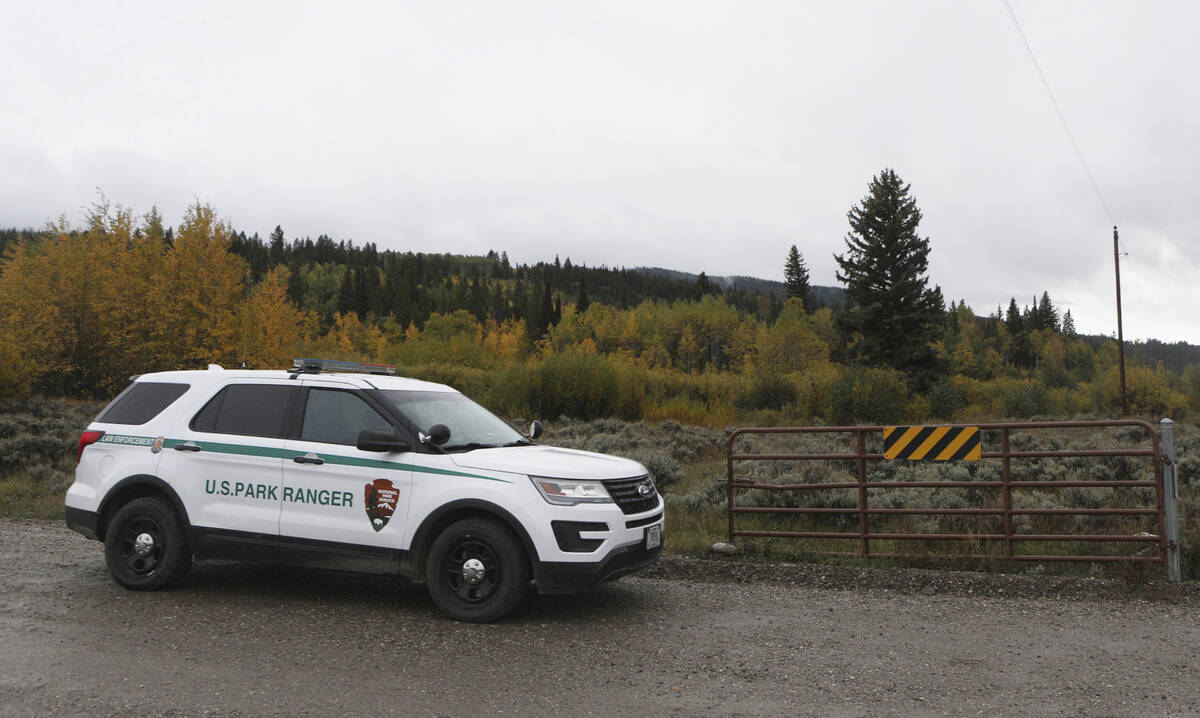 A U.S. Park Ranger vehicle drives in the Spread Creek area in the Bridger-Teton National Forest ...
