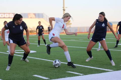 Coronado's Molly Russell (9) dibbles the ball away from Centennial's Keyla Alba (23) and Gabrie ...