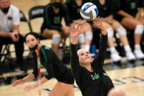Palo Verde's Rilee Read (15) sets as her teammate Emma Neville (6) runs up behind to spike duri ...