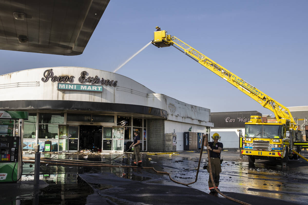 Clark County firefighters on the scene of a fire that damaged Pecos Express convenience store o ...
