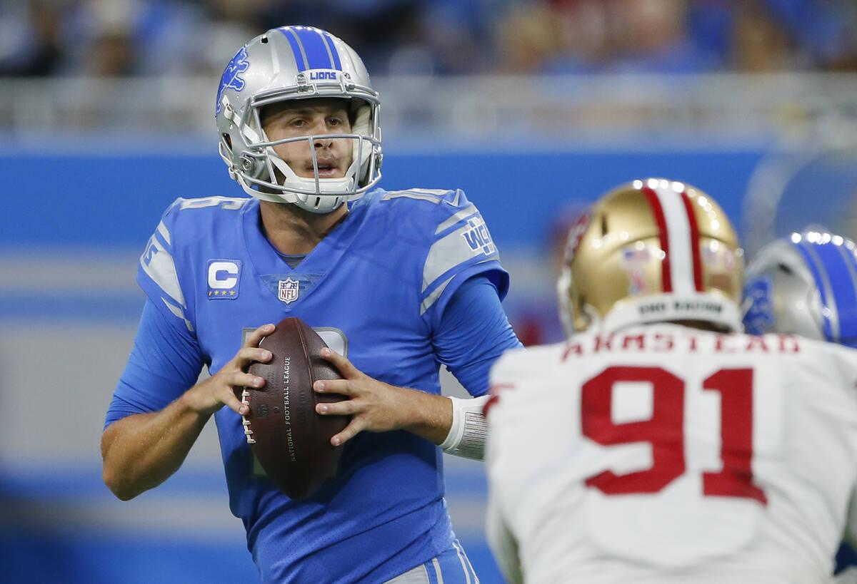 Detroit Lions quarterback Jared Goff (16) looks to pass against San Francisco 49ers defensive e ...