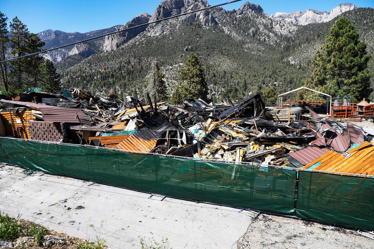 Debris of the former Mount Charleston Lodge is fenced off on Monday, Sept. 20, 2021. (Rachel As ...